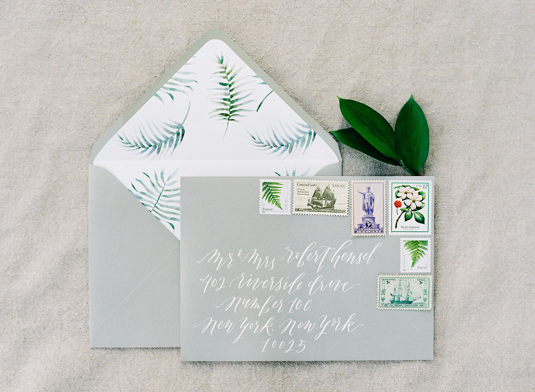 la Happy Design & calligraphy custom envelops with vintage postage